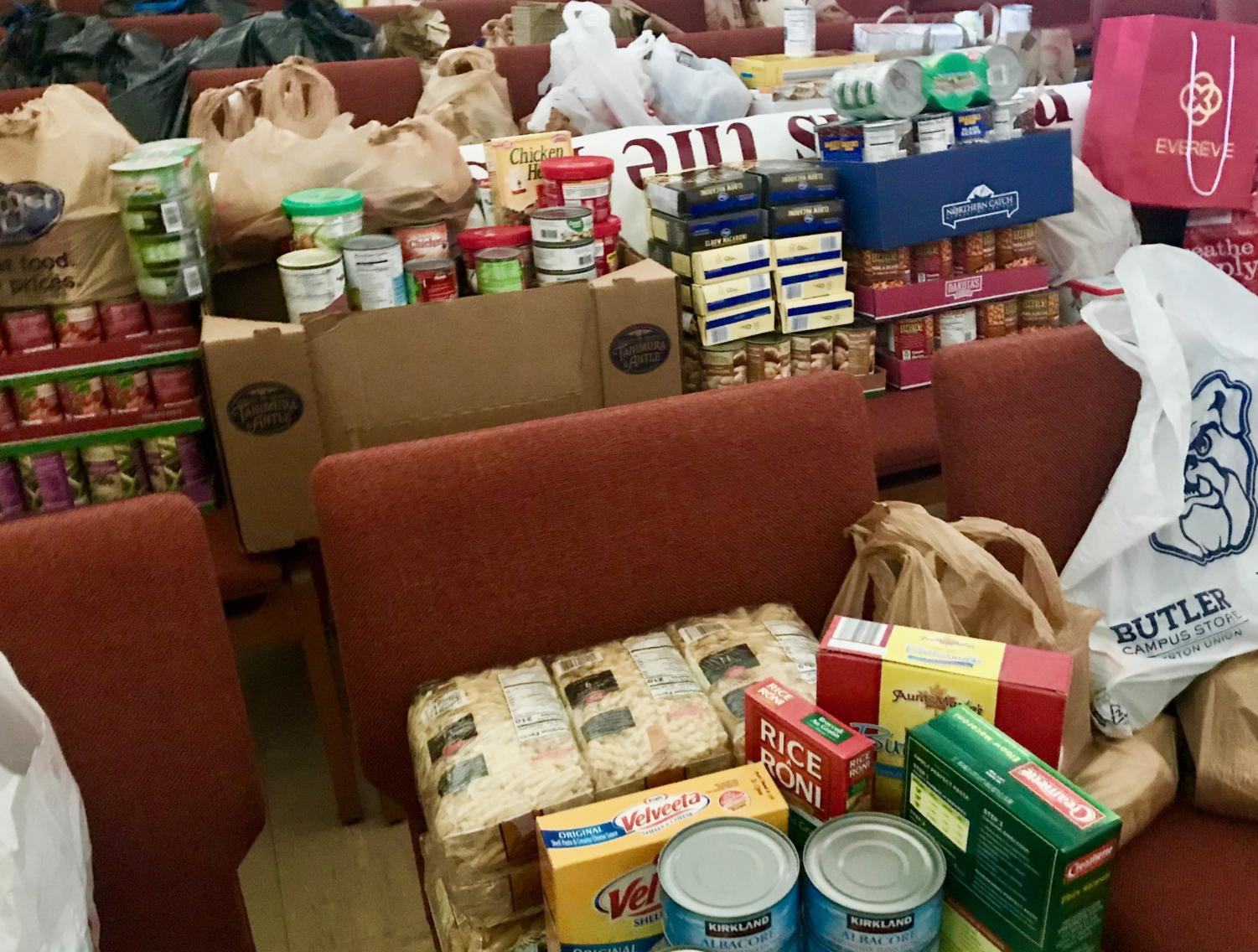 Nonperishable goods for the food drive slowly pile up in the chapel.