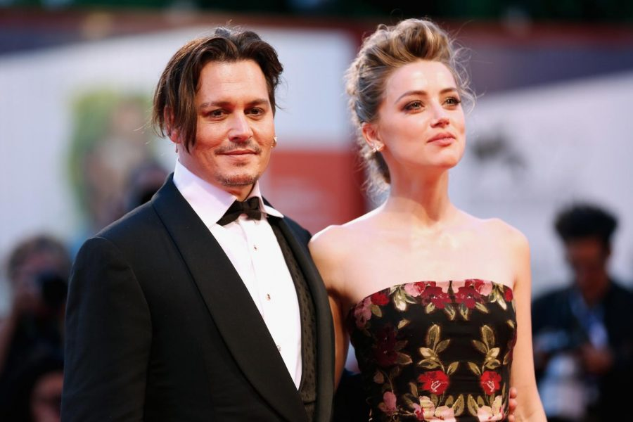 Amber Heard and Johnny Depp when they were still together Photo Credit: NBC News