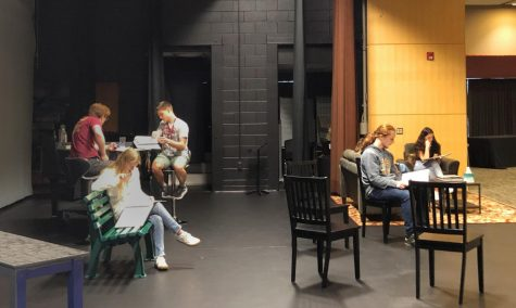 Students rehearse a scene in Act 2 of 110 Stories, which premieres Friday night.